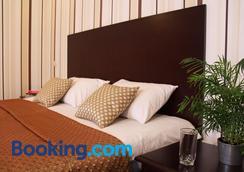 Hotel Business Apartments - เนปรอเปตอฟส์ - ห้องนอน
