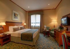 Golden Tulip Al Barsha - ดูไบ - ห้องนอน