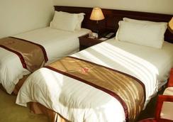 Shanghai Airlines Travel Hotel - เซี่ยงไฮ้ - ห้องนอน