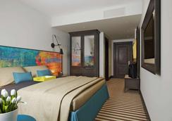 Panorama Hotel - ลวิฟ - ห้องนอน