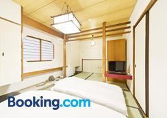 Business Hotel Yamashiro - โตเกียว - ห้องนอน