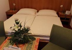 Airporthotel Salzburg - ซาลส์บูร์ก - ห้องนอน