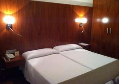 Hotel Sercotel Familia Conde - อูเอลบา - ห้องนอน