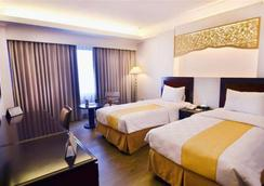 Kyriad Hotel Bumiminang - ปาดัง - ห้องนอน