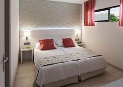 Hotel Flor Los Almendros - เปเกร่า - ห้องนอน