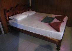 ตาโต๊ะรีสอร์ท แอนด์ ฟรีดอมบีชรีสอร์ท - เกาะเต่า - ห้องนอน