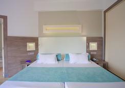 FERGUS Bermudas - ปาลมา โนวา - ห้องนอน