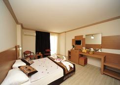 Happy Elegant Hotel - อลันยา - ห้องนอน