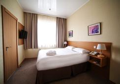 City Hotel Bishkek - บิชเคก - ห้องนอน