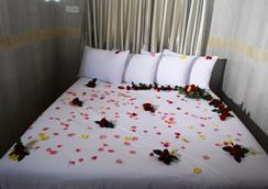 Hotel Grand United (Chinatown) - ย่างกุ้ง - ห้องนอน