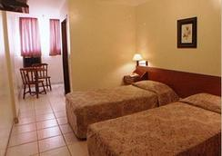 Hotel Kananxuê - โกยาเนีย - ห้องนอน