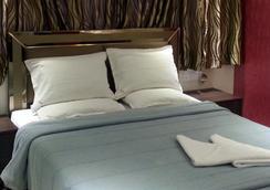 Hotel Kamran Residency - มุมไบ - ห้องนอน