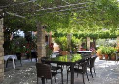 Pension Dandidis - คอร์ฟู (เคอร์คีร่า) - ร้านอาหาร
