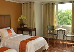 The Corporate Inn Hotel - มะนิลา - ห้องนอน