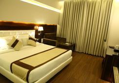Viceroy Inn Dehradun - เดห์ราดุน - ห้องนอน