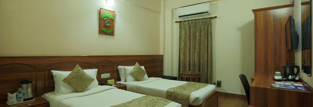World choice Nandan Premier Hotel - Guwahati - Bedroom