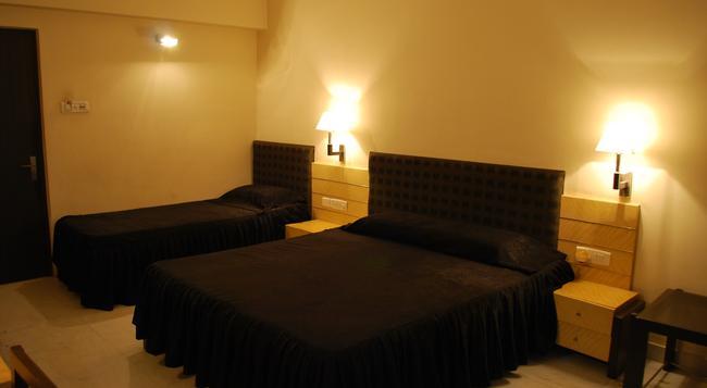 Hotel Millennium - Guwahati - Bedroom