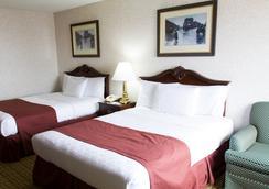 GuestHouse Inn & Suites Sioux Falls - ซูฟอล - ห้องนอน