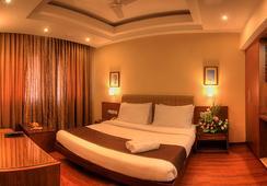 Hotel Deepa Comforts - มังคาลอร์ - ห้องนอน
