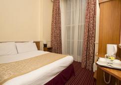 Reem Hotel - ลอนดอน - ห้องนอน