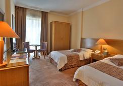 Alqasr Metropole Hotel - อัมมาน - ห้องนอน
