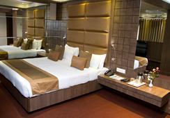 Hotel Centre Point - นาคปุระ - ห้องนอน