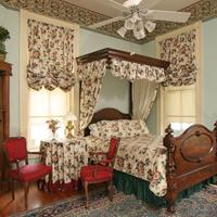 Noble Inns Jackson House Room 1 at this San Antonio B&B features a luxurious queen bed and Jacuzzi tub