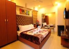 Hotel Pearl Inn & Suites - อัมริตสา - ห้องนอน