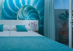 Hotel Apartamentos Marina Playa - Adults Only - ซาน อันโตนิโอ เด พอร์ตมานี - ห้องนอน