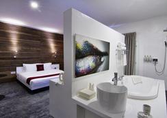 Le Blanc Boutique Hotel - พนมเปญ - ห้องนอน