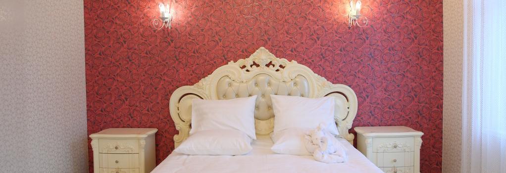Aparthotel Nostalgia - Nizhniy Novgorod - Bedroom