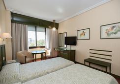 Hotel América Sevilla - เซบีญ่า - ห้องนอน