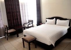 Quiet Haven Hotel - คิกาลี - ห้องนอน