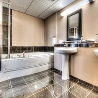 Podollan Rez-idence Grande Prairie Elegant bathrooms with walk-in shower & soaker tub