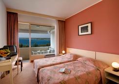 Pical Hotel - โพเรซ - ห้องนอน