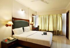 Fabhotel Lotus Koregaon Park - ปูเน่ - ห้องนอน