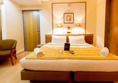 Fabhotel Gandharva Shivajinagar - ปูเน่ - ห้องนอน