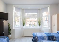 Guesthouse Living & Sleeping Eindhoven - ไอนด์โฮเวน - ห้องนอน
