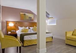 Hotel Puerta de Toledo - มาดริด - ห้องนอน