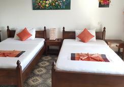 The Little Garden Boutique Hotel - พนมเปญ - ห้องนอน