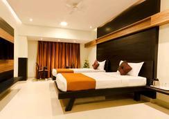 Prajwal By Mango Hotels - เบงกาลูรู - ห้องนอน