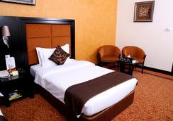Royal Grand Suite Hotel - ชาร์จาห์ - ห้องนอน