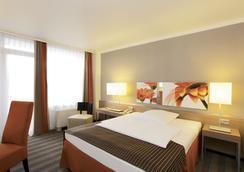 H4 Hotel Frankfurt Messe - แฟร้งค์เฟิรต์ - ห้องนอน