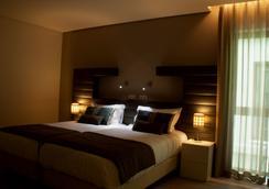 Aqua Ria Boutique Hotel - แฟโร - ห้องนอน