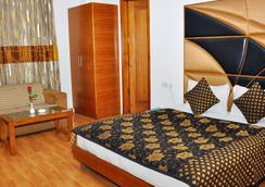 Hari's Court Inns & Hotels - นิวเดลี - ห้องนอน
