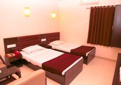 Hotel Golden Plaza - อาเมดาบัด - ห้องนอน