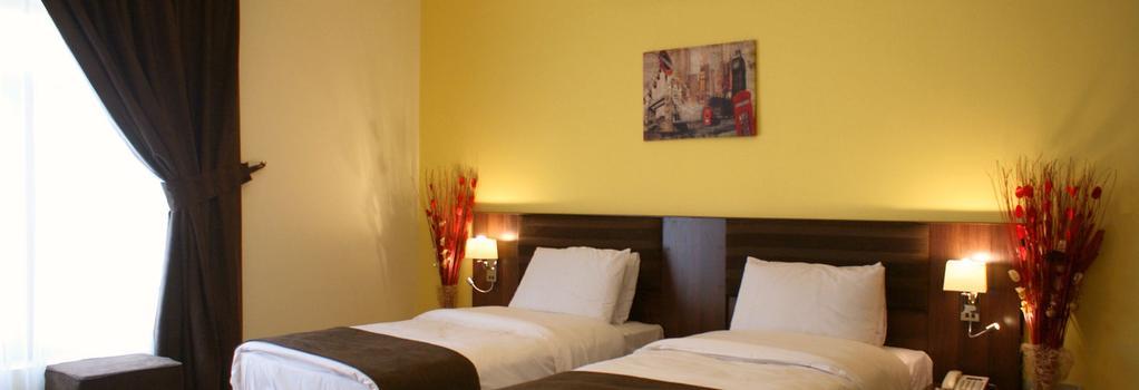 Weekend Hotel Apartments - Muscat - Bedroom