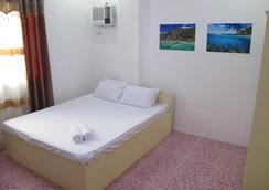 Cool Stay Inn - มาเล - ห้องนอน