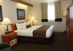 Northern Plains Inn - ไมนอต์ - ห้องนอน