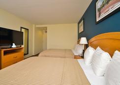 Magnuson Convention Center Hotel - นิวยอร์ก - ห้องนอน